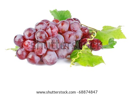 Fresh red grapes with green leaves isolated on white background - stock photo