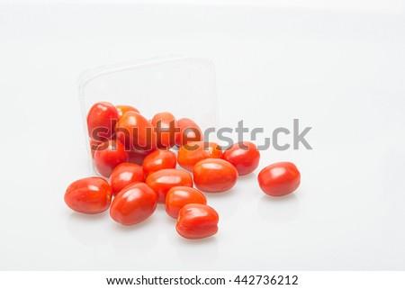 fresh red mini tomatoes on white background - stock photo