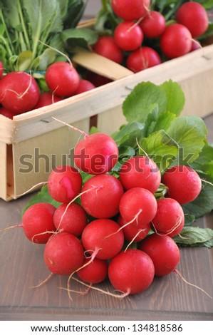 Fresh red radish in a box - stock photo