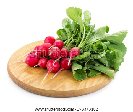 Fresh red radish on wooden board isolated on white - stock photo