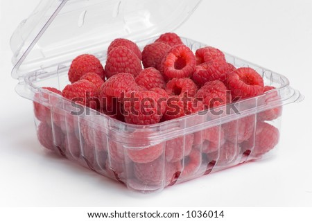 fresh, red raspberries in plastic fruit container - stock photo