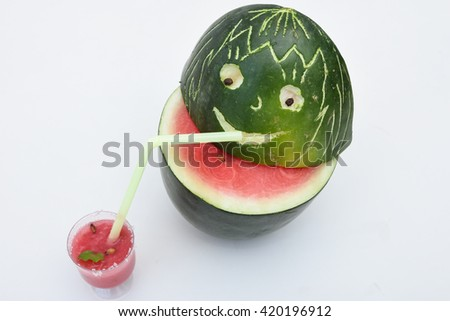 Fresh red ripe watermelon drink / juice in glass with slices of watermelon, India. Healthy refreshing  drink for hot summer. Smiley drinking fresh juice    - stock photo