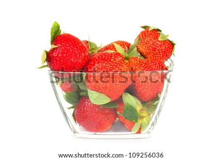 Fresh red strawberries in glass bowl isolated on white background