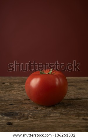 fresh red tomatoes on a wooden table