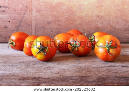 Fresh Red Tomatoes on Wooden as Background. - stock photo