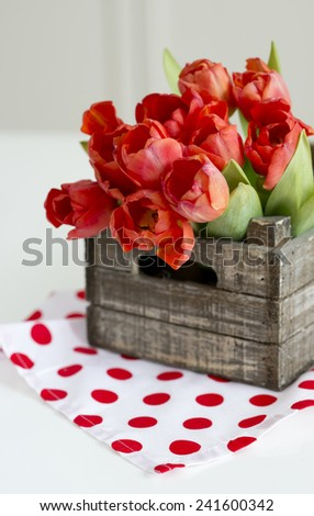 Fresh red tulips in the vintage box - stock photo