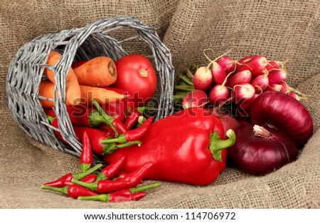 fresh red vegetables on sackcloth background - stock photo