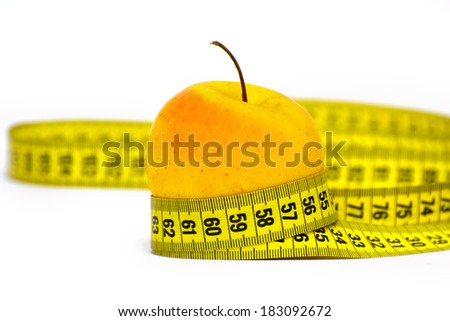 fresh red-yellow apple with measuring tape. isolated over white background  - stock photo