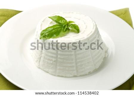 fresh ricotta with basil leaf - stock photo