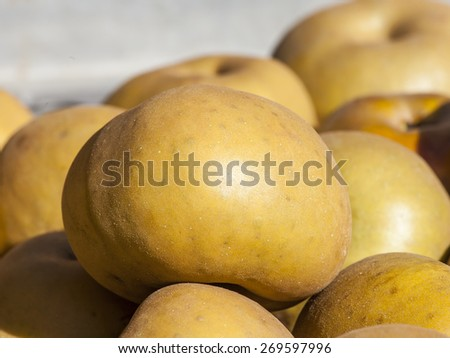 Fresh ripe apples on a market counter - stock photo