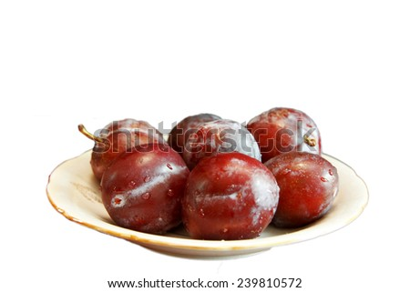 Fresh Ripe Black Plums In A White Plate Isolated On White Background - stock photo