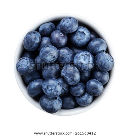 fresh ripe blueberries in white bowl directly above - stock photo