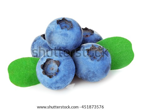Fresh ripe blueberries with leaves close-up isolated on a white background.