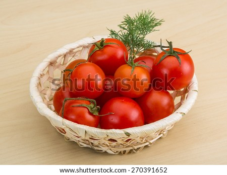 Fresh ripe Cherry tomatoes in the basket - stock photo