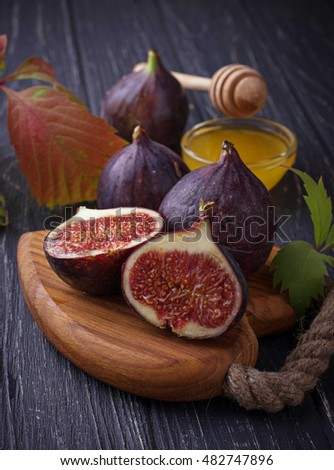 Fresh ripe figs and honey. Selective focus