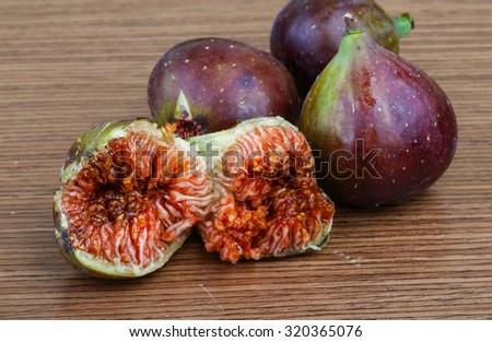 Fresh ripe Figs on the wood background - stock photo