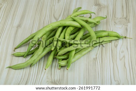 Fresh ripe Green beans heap on the wooden background - stock photo