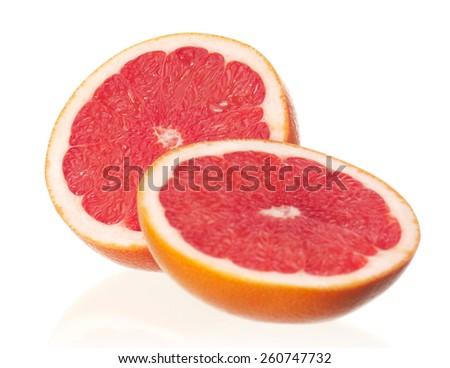 Fresh ripe half grapefruit on white background  - stock photo
