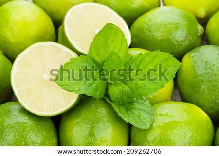 Fresh ripe limes with mint closeup - stock photo