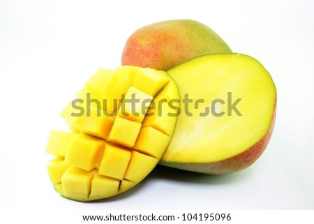 Fresh ripe mango (Mangifera indica) with a section cut in squares on a white background. - stock photo