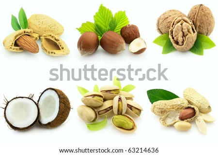 Fresh ripe nuts with leaves - stock photo
