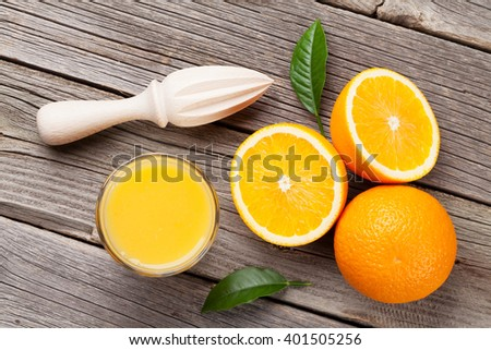 Fresh ripe oranges and juice on wooden table. Top view - stock photo