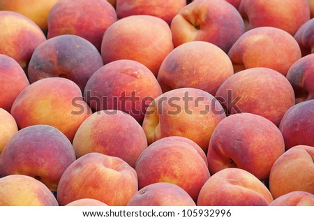 fresh ripe peaches in the box ready for sale - stock photo