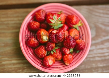 Fresh ripe perfect strawberry on wooden table - stock photo