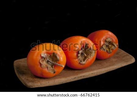 Fresh ripe persimmon isolated on white background - stock photo