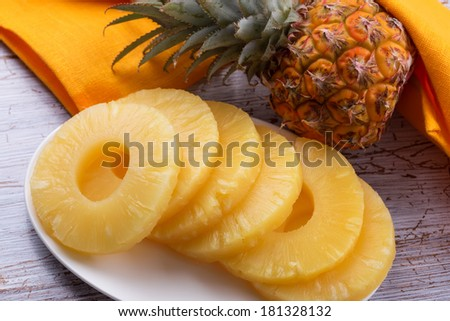 Fresh ripe pineapple (ananas) on wooden background. Selective focus. - stock photo
