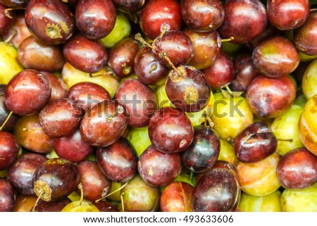Fresh Ripe Plums or Blackthorns Texture, violet blue red purple sweet fresh organic plum as background, top view of juicy natural plums with tails, high quality resolution