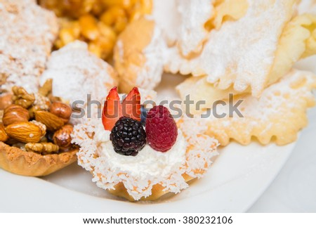 Fresh ripe Raspberry and blackberry on a white background - stock photo