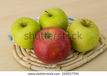 Fresh ripe Red and green apples on wood background