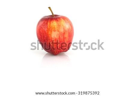 Fresh Ripe red apple isolated on a white background