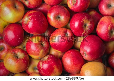 Fresh ripe red apples in a store as background, close up, top view, raw food, vegan - stock photo