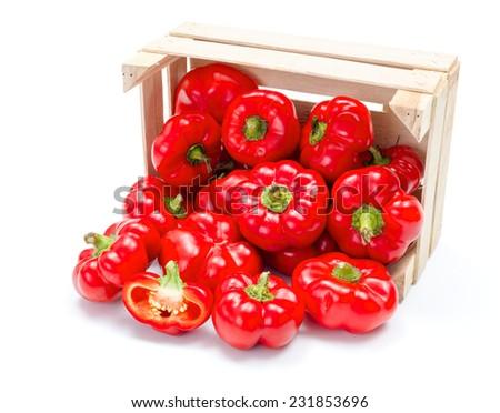 Fresh ripe red hungarian apple pepper (almapaprika) crop in wooden crate - stock photo