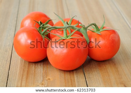 Fresh ripe red tomatoes on the wooden table