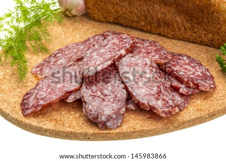 Fresh ripe salami with bread and vegetables