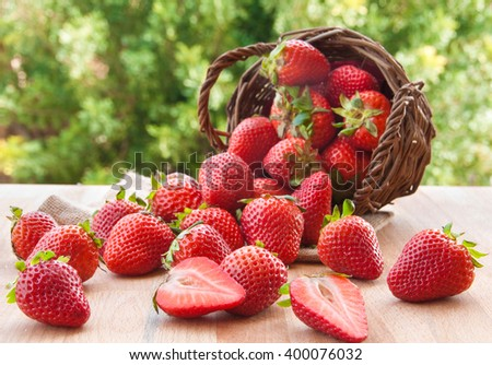 Fresh ripe strawberries in fallen basket