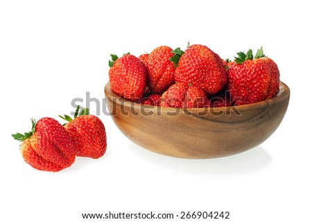 Fresh ripe strawberries in wooden bowl isolated on white background. Closeup. - stock photo