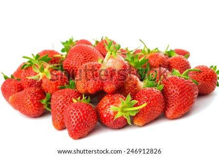 Fresh ripe strawberries on a white background - stock photo