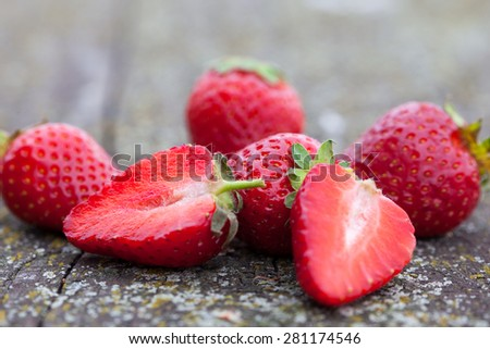 Fresh ripe strawberries on rustic table  - stock photo