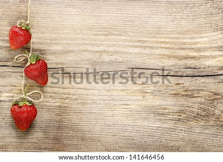 Fresh ripe strawberries on wooden background. Copy space. - stock photo