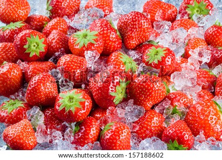 Fresh ripe strawberry with ice. Fruit Background - stock photo