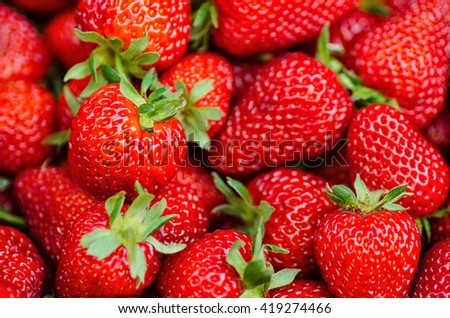 Fresh, ripe, sweet perfect strawberries as a background. Selective focus
