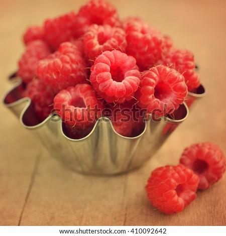 Fresh ripe sweet raspberries, selective focus, toned - stock photo