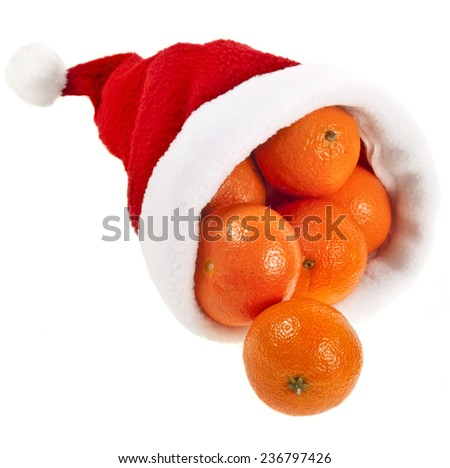 Fresh ripe tangerines in a christmas hat  isolated on a white background - stock photo