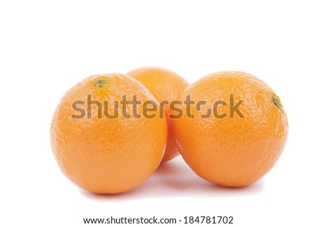 Fresh ripe tangerines on a white background. - stock photo