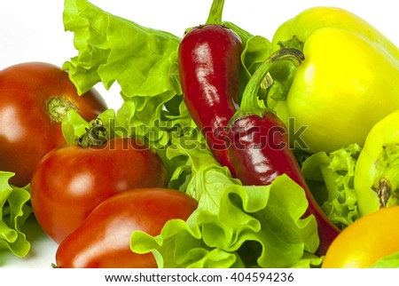 fresh ripe vegetables and salad on white background - stock photo
