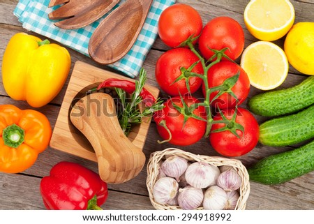 Fresh ripe vegetables and spices on wooden table - stock photo